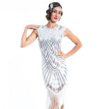 A white flapper dress with silver sequins, beads and white fringes around the hem - Close View