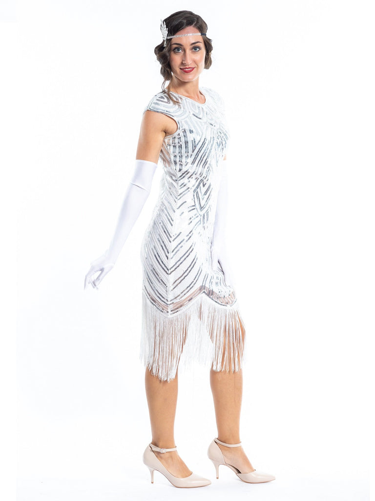 A white flapper dress with silver sequins, beads and white fringes around the hem - Side View
