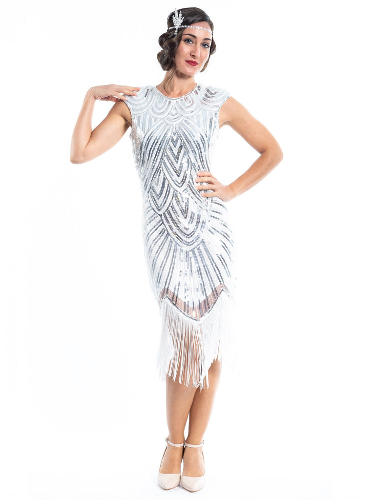 A white flapper dress with silver sequins, beads and white fringes around the hem