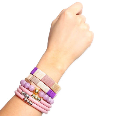 Three Kings Pink All Weather Bangle, FÜCL® Quietude Cuff Set, and Purple Bianca Beaded Bracelet Styled on hand | BuDhaGirl