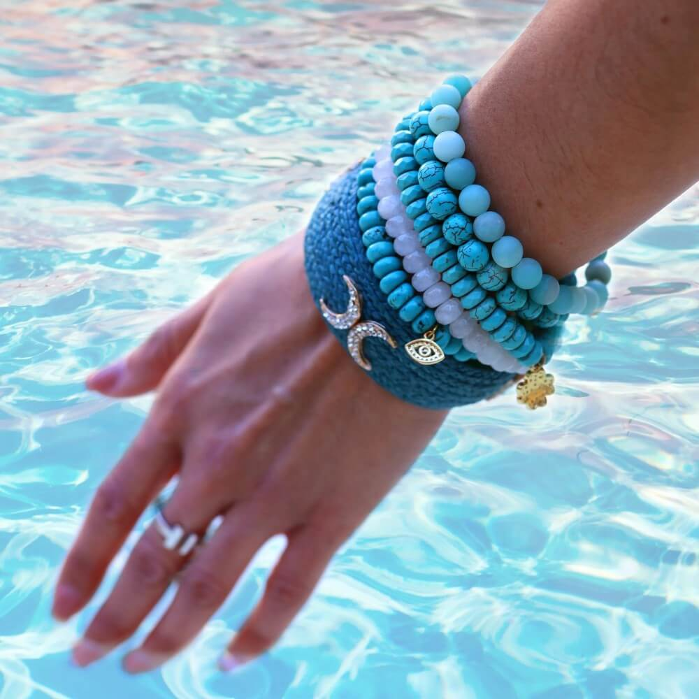 Straw Cuffs Styled With Chamonix Bracelets above a pool | BuDhaGirl