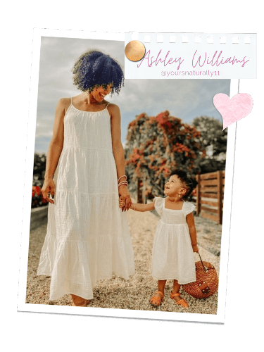 Ashley Williams holding her daughter's hand | BuDhaGirl