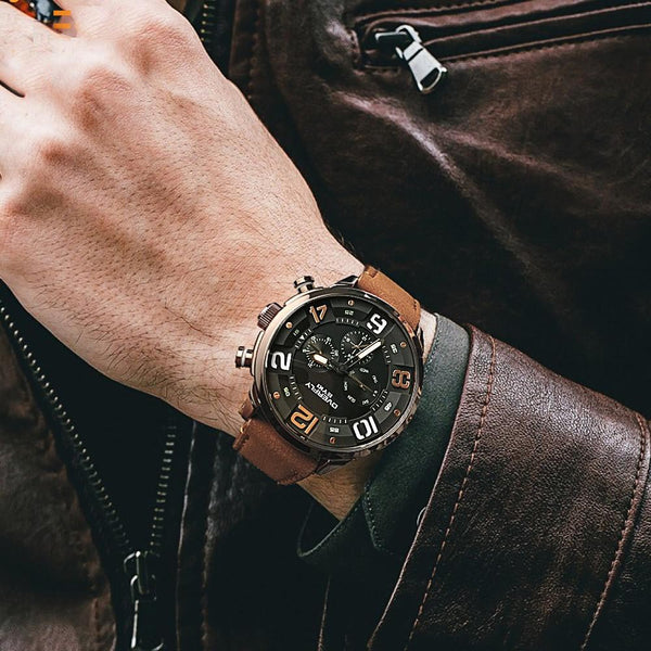 DENOMINATOR sport watch - on hand with leather jacket
