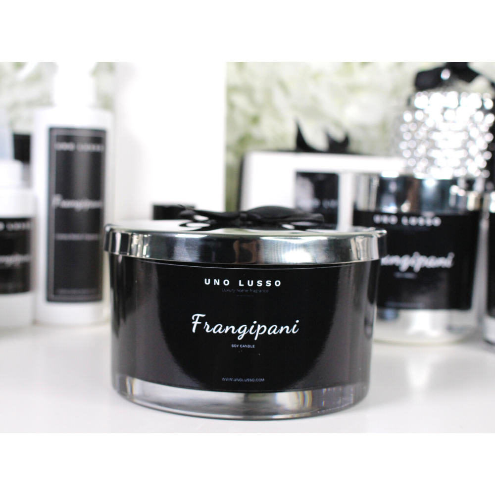 Large 4 wick candle - black glass with silver lid - Frangipani - Uno Lusso