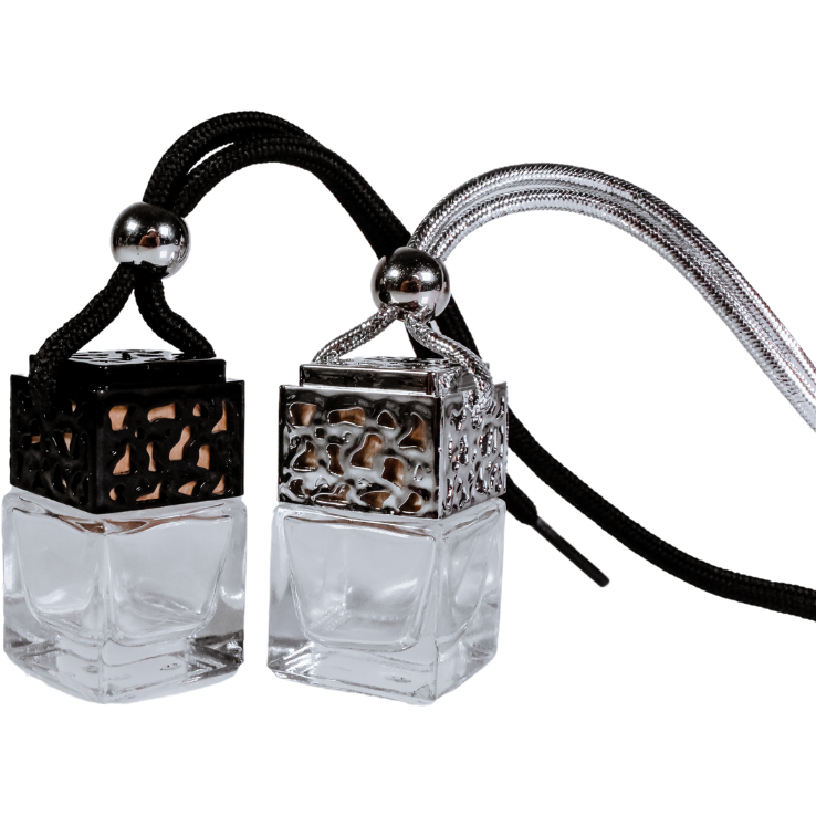 Black and silver car diffusers filled with Enchanted Forest fragrance oil by Uno Lusso