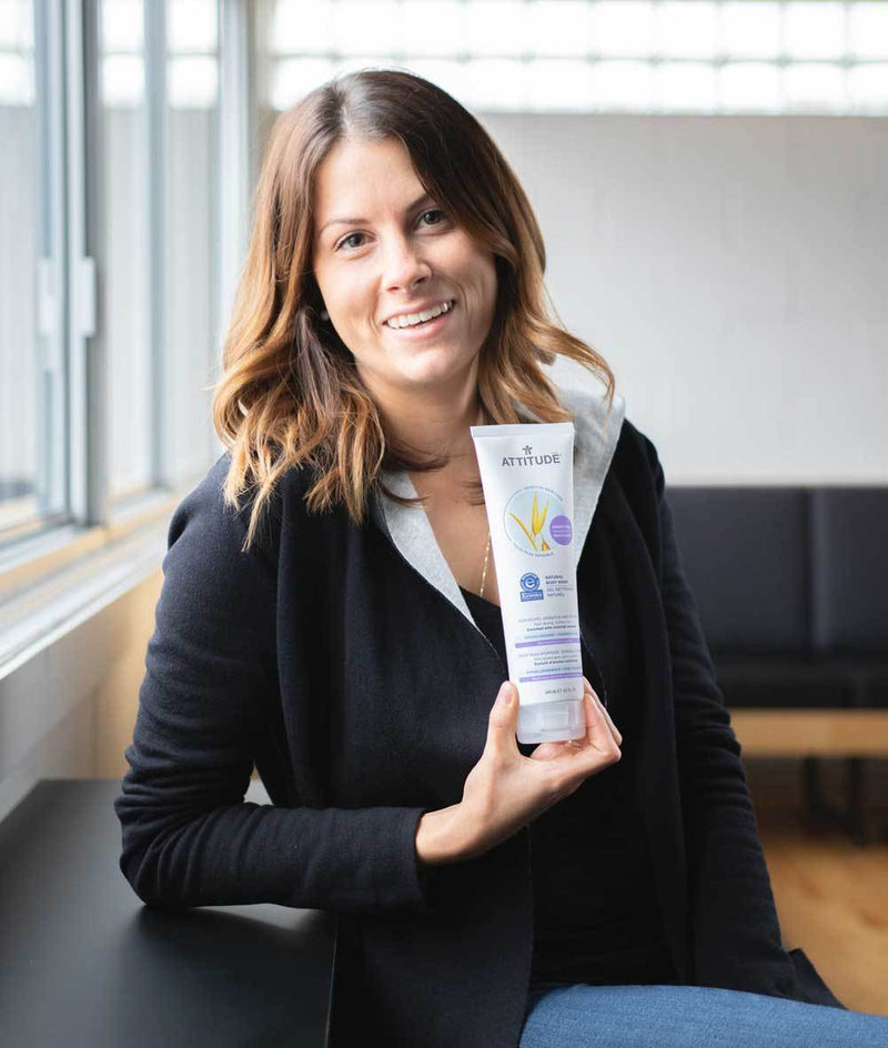 60114-Employee smiling while holding with her right hand ATTITUDE Volumizing Conditioner For Sensitive Skin_en?_team?
