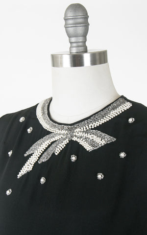 1950s Beaded Bow Black Rayon Blouse | medium