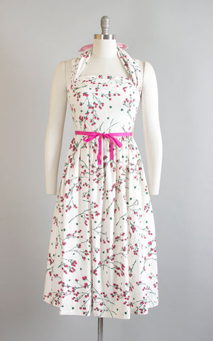 Vintage 1950s Dress | 50s Cherry Blossom Floral Print Cotton Sundress Criss Cross Halter White Pink Full Skirt Day Dress (small)