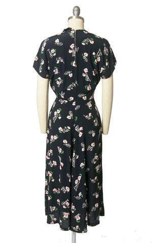 Vintage 1940s Dress | 40s Music Instruments Novelty Print Floral Rayon Crepe Navy Blue Cocktail Dress (small)