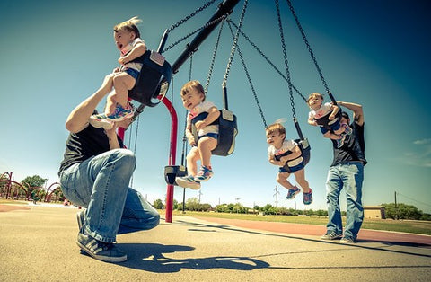 parents play swing with children