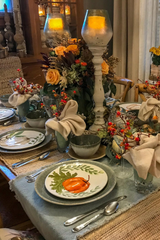 Fall tablescape with pumpkin plates and tall pillar candles