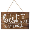 """The Best Is Yet to Come"" Wooden Sign Wall Decor in White Print"
