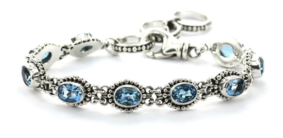 B004BT PADMA Faceted Swiss Blue Topaz Station Bracelet.  Bali .925 Sterling Silver