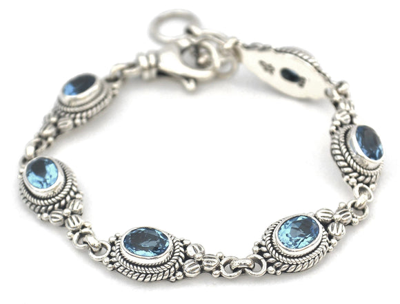B012BT PADMA Faceted Swiss Blue Topaz Flower Station Bracelet