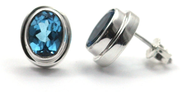 E222BT PADMA Swiss Blue Topaz High Polish Polos Finish Post Earrings.  Bali .925 Sterling Silver