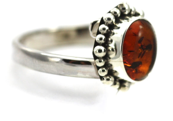R004AB PADMA Ring with Beaded Setting and a 6x8mm Amber Stone