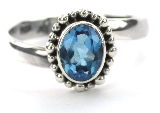 R004BT PADMA Adjustable Ring with Beaded Setting and a 6x8mm Swiss Blue Topaz Stone