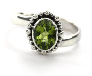 R004PD PADMA Adjustable Ring with Beaded Setting and a 6x8mm Peridot Stone