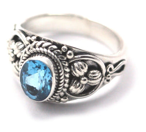 R012BT PADMA .925 Sterling Silver Ring Handmade in Bali With Floral Accents and a Faceted 6x8mm Swiss Blue Topaz Stone