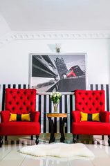 we love the red color accent chair that brought out the brightness of the space