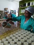 Soylites artisan pouring soy wax candles