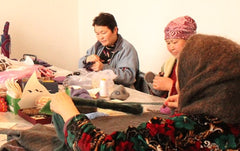 Kork fiber artisans as work making Zooties!