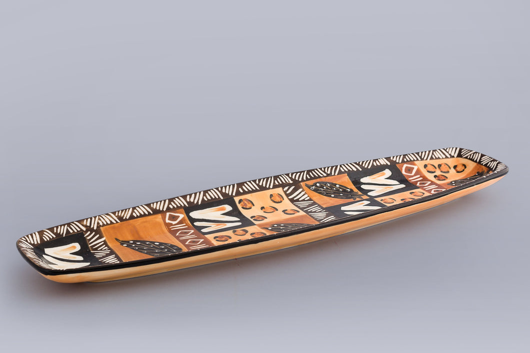 Oblong ceramic serving platters hand crafted in South Africa. Animal print. Fair trade.