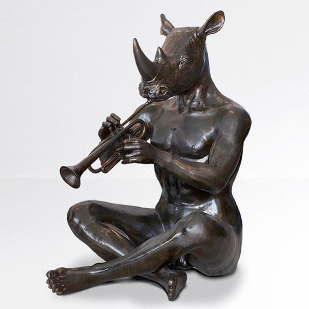 He loved playing the horn for obvious reasons (Bronze Sculpture)