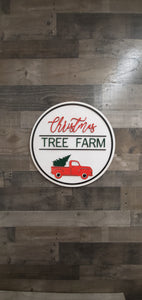Christmas Tree Farm with red truck round sign