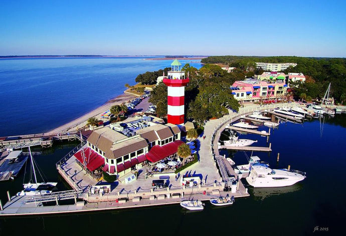 Head Island Island - Harbour Town Lighthouse aerial marina and beach view
