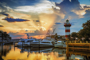 Head Island Island - Sunset bursting over Harbour Town Lighthouse