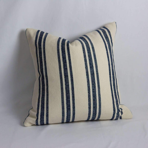 Luxury decorative pillow cover, in stripped patten of blue and white, adding that final layer design and decor to any room in your home.  The perfect accent; this pillow cover is locally made. Other Features:  Hidden zipper to allow for easy addition of your choice of feather or poly fiber-fill insert (purchased separately).  The pillow cover is suited to the simplicity of the knife edge seam. Inside edges finished where applicable to minimize fraying. Sizes:  24 x 24 standard sizing or client can requ