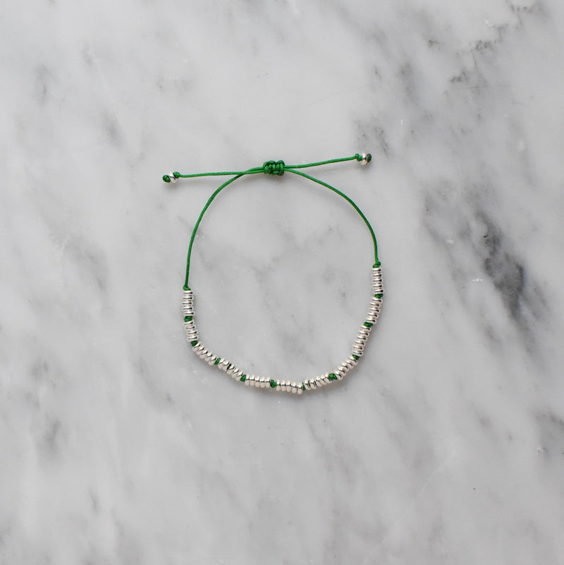 green nylon and sterling silver bracelet
