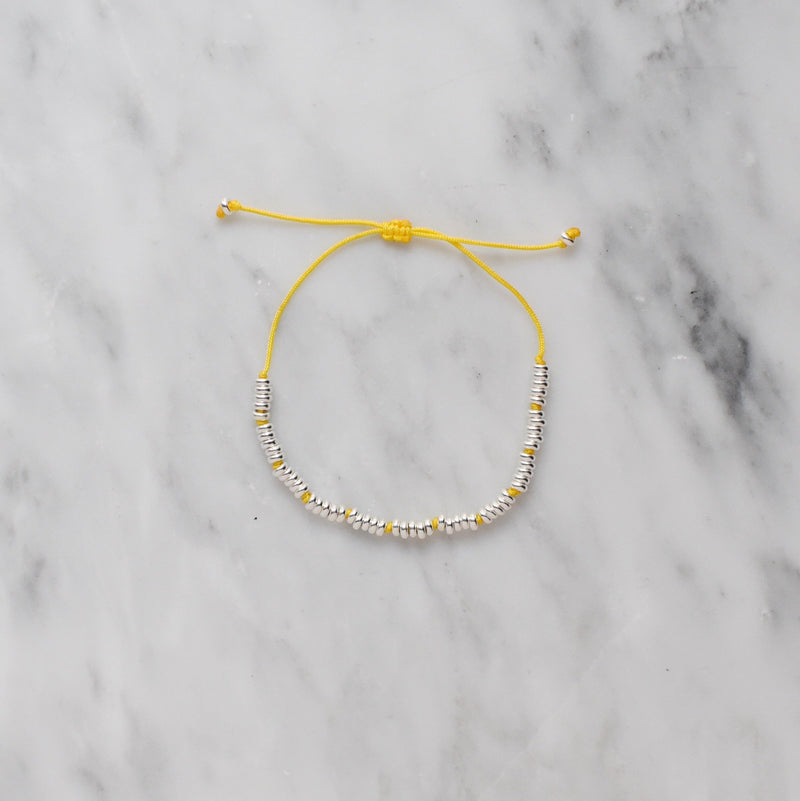 yellow nylon and sterling silver bracelet