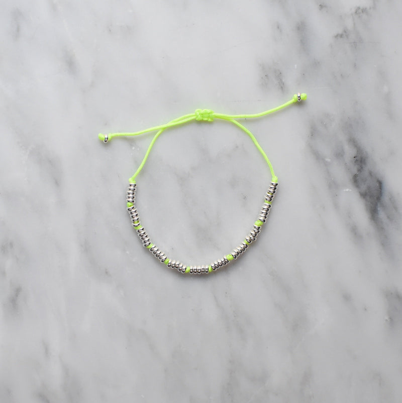 neon yellow nylon and sterling silver bracelet