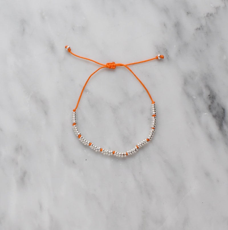 orange nylon and sterling silver bracelet