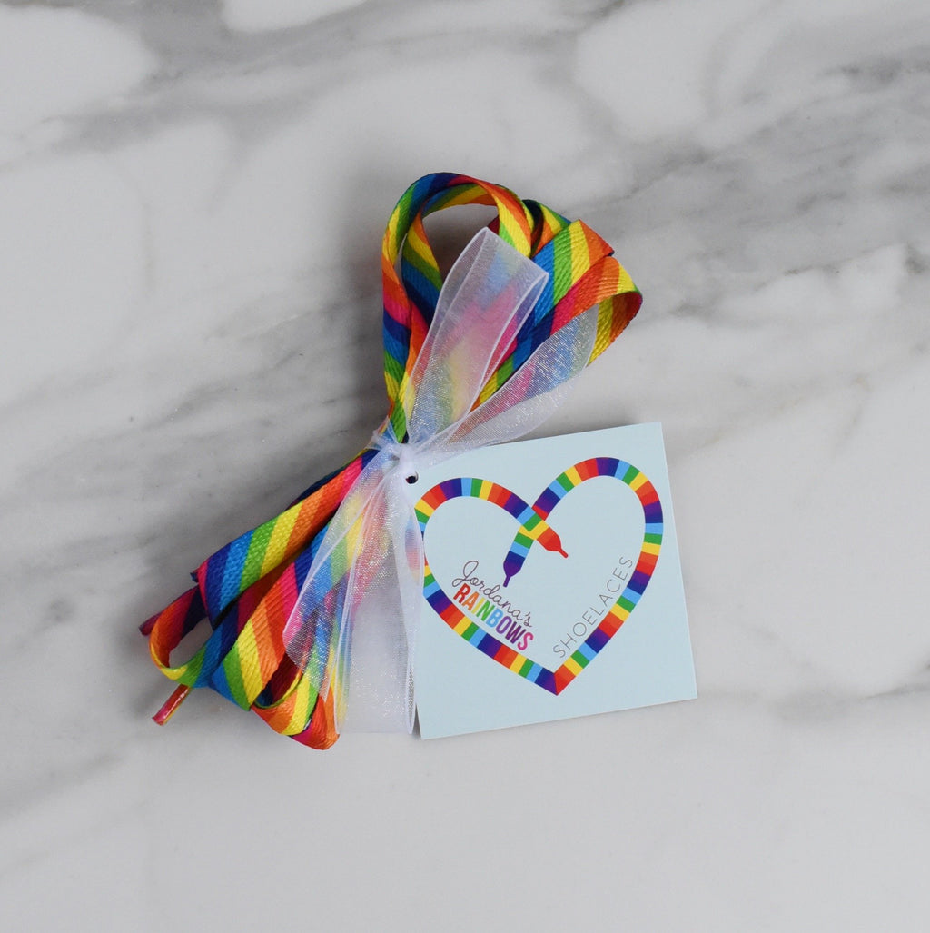 Rainbow striped shoelaces tied in a bundle with a tag
