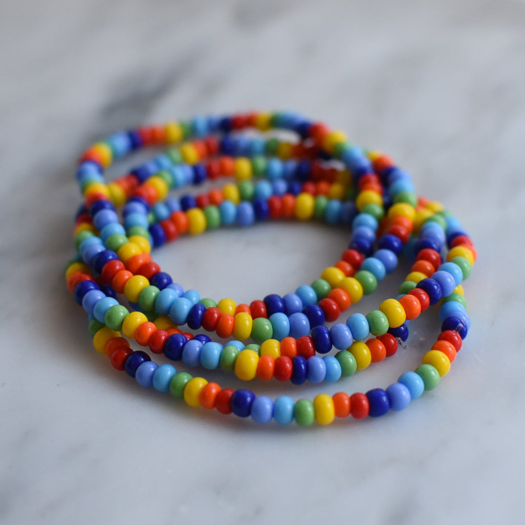 stacked rainbow coloured bead bracelets