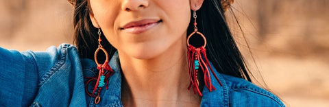 Dark haired model wearing red leather fringe earrings with turquoise by Buckaroo Bling