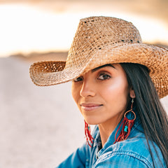 Dark haired model wearing a straw cowboy hat