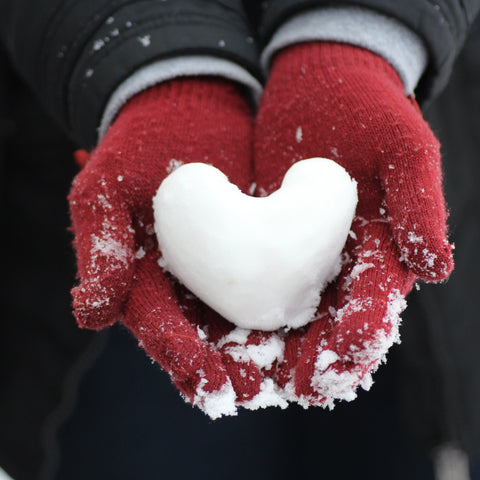 Heart shaped snow ball on red gloves; photo by Mara Ket