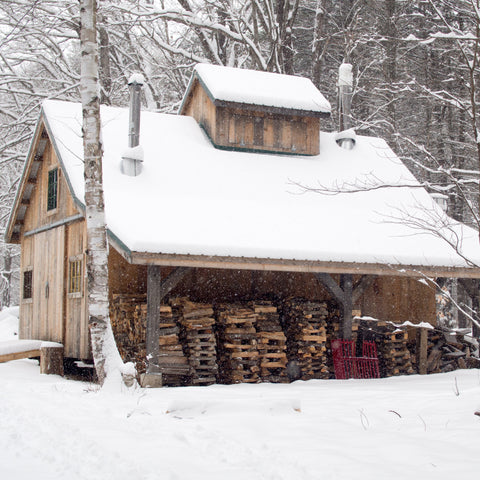 Wood barn in the snow - photo by Mike Petrucci