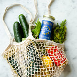 Grocery bag with vegetables and sauce bottles