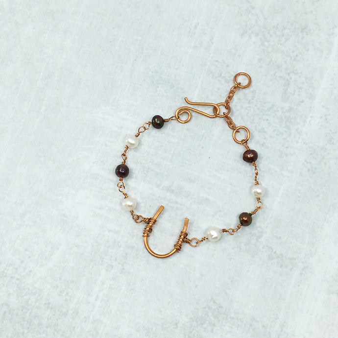 Copper horseshoe and freshwater pearl bracelet by Buckaroo Bling