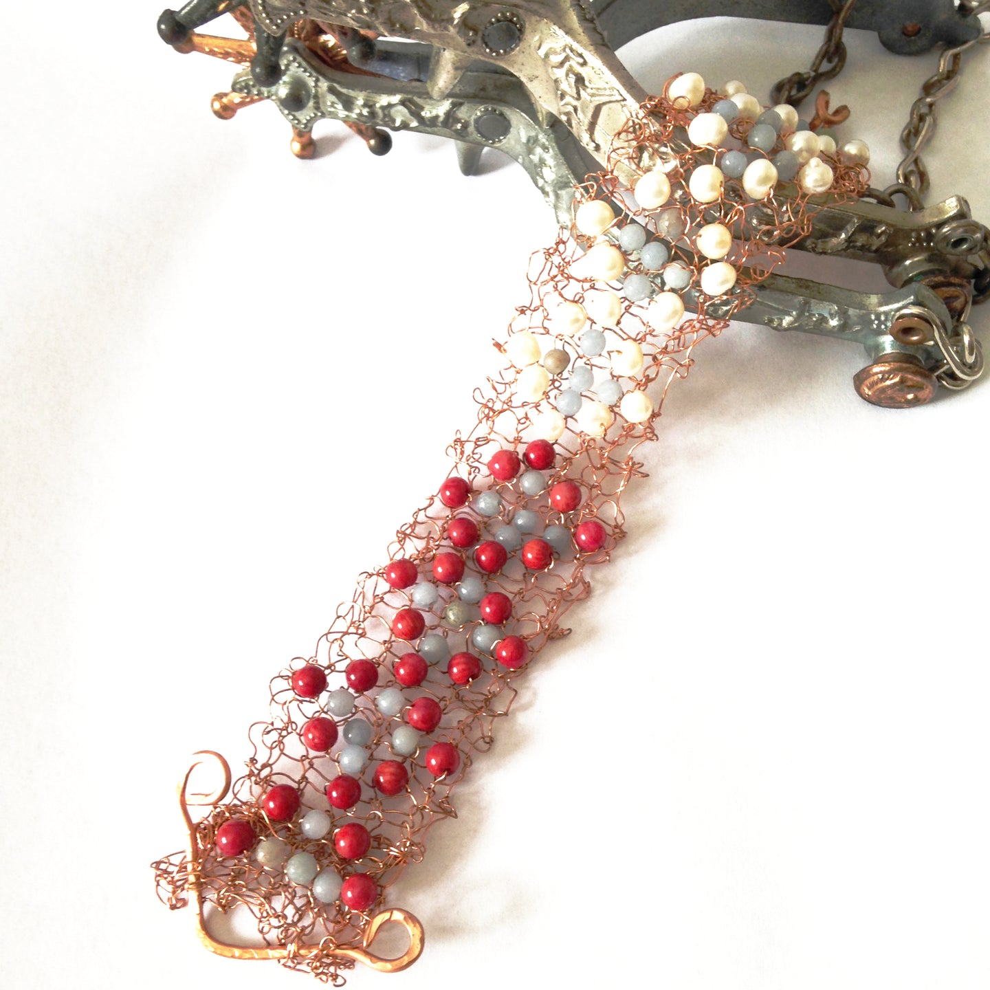 One-off knitted copper bracelet with pearls and gemstones by Buckaroo Bling