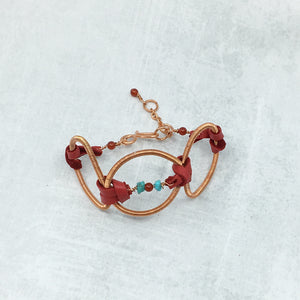 Adjustable copper and leather bracelet with turquoise