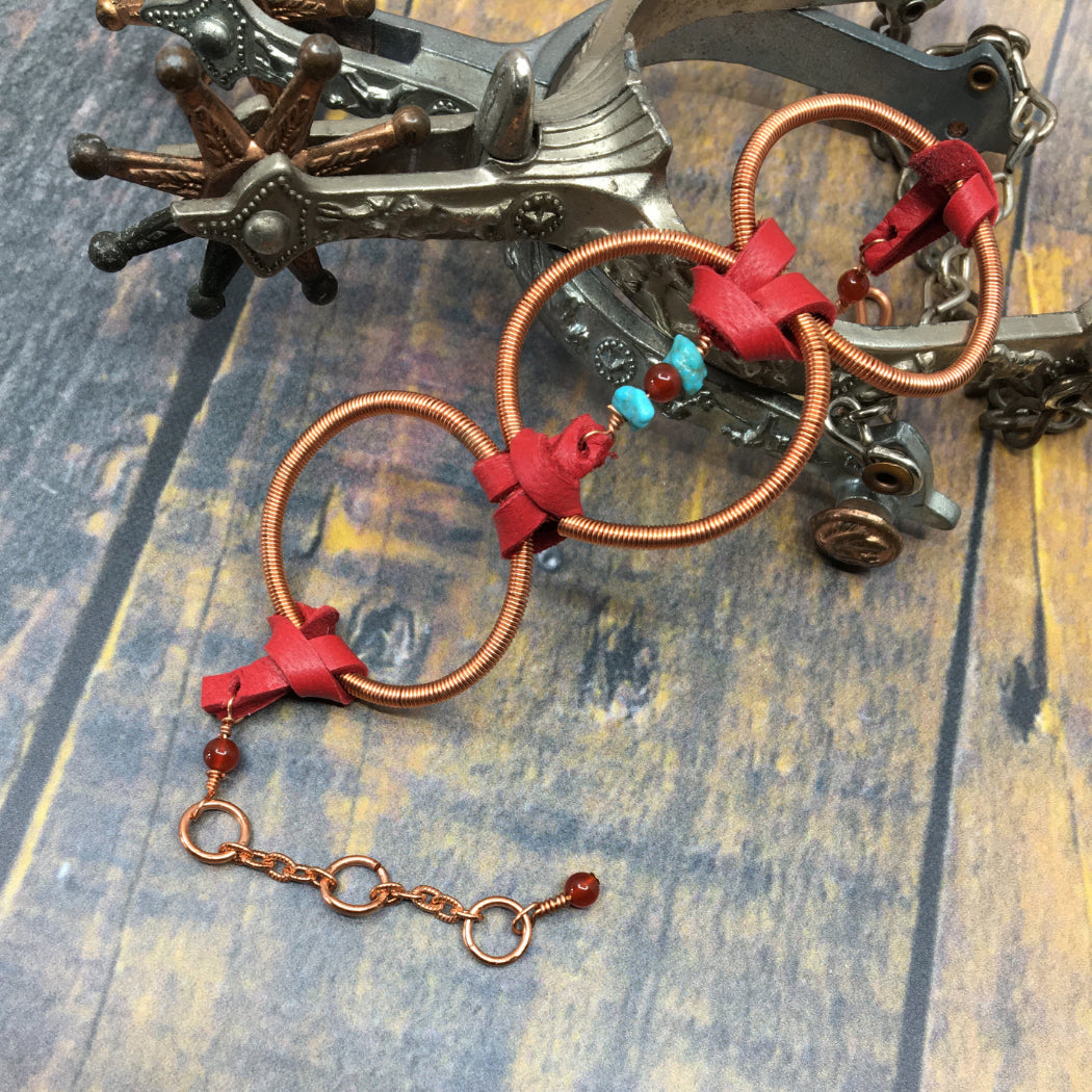 Statement bracelet with copper hoops and deer leather