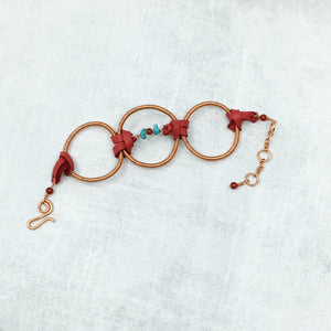 Three hoop copper bracelet with turquoise and leather