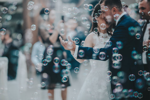 newly weds dancing at wedding with bubbles