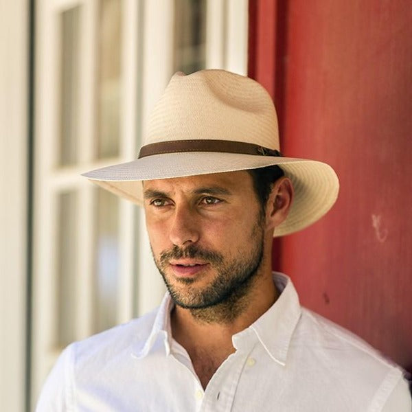 Handsom man wearing beige panama hat